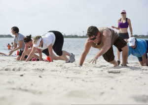 800px-Participants_of_a_beach_boot_camp_class_crawl_across_Soundside_Beach_at_Hurlburt_Field,_Fla.,_May_18,_2013_130518-F-RS318-003